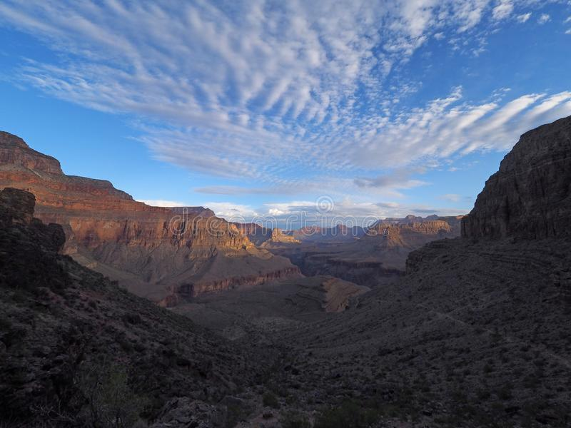 Sunrise on the Hermit Trail in Grand Canyon National Park. Sunrise and first light on the canyon walls on the Hermit Trail in Grand Canyon National Park royalty free stock image