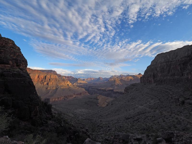 Sunrise on the Hermit Trail in Grand Canyon National Park. Sunrise and first light on the canyon walls on the Hermit Trail in Grand Canyon National Park royalty free stock photography