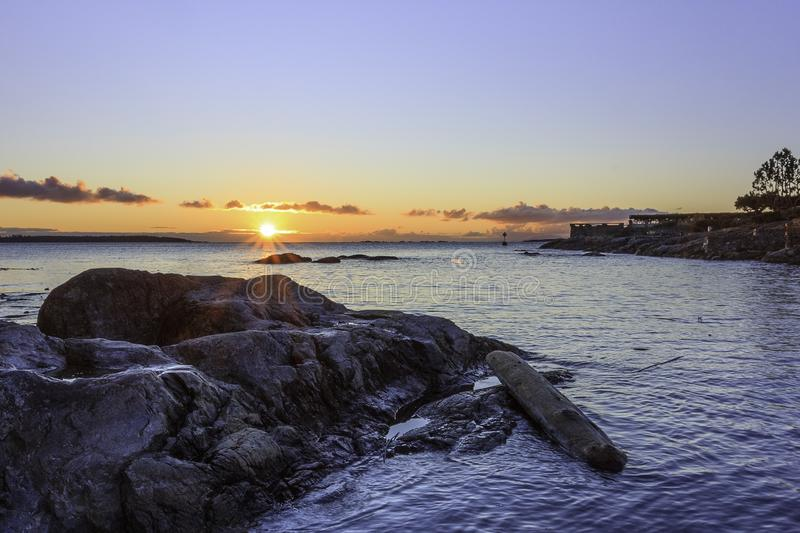 Sunrise in hidden cove at Cattle Point in British Columbia stock images