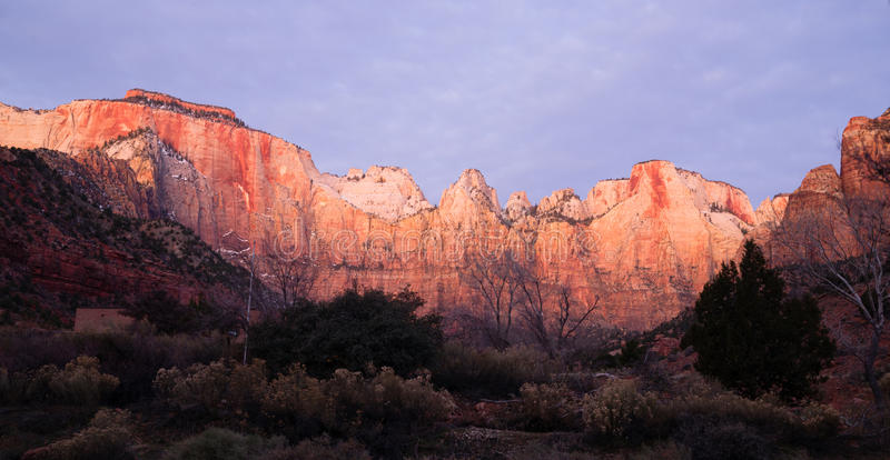 Sunrise High Mountain Buttes Zion National Park Desert Southwest. The light has not quite reached the valley int this vertical composition of early morning in royalty free stock photo
