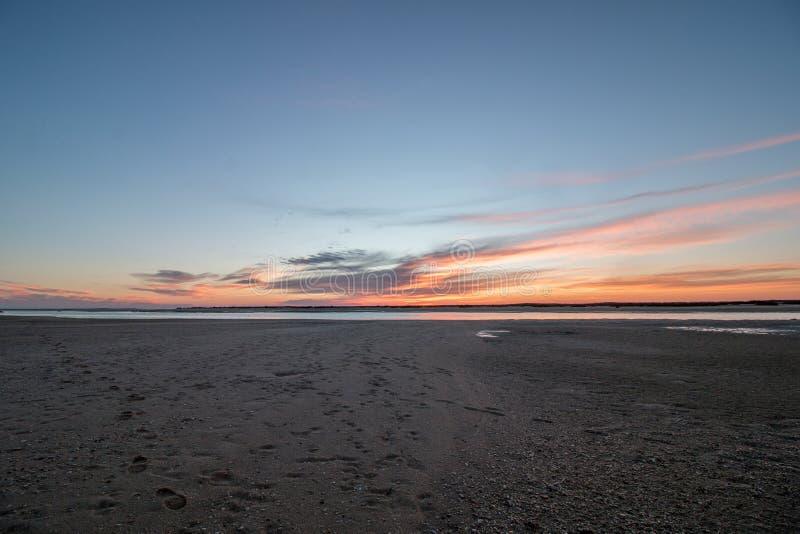 Sunrise horizon line on a deserted beach. Wide view of sunrise horizon line on a deserted beach stock photography