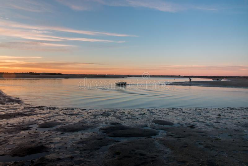 Sunrise horizon line on a deserted beach. Wide view of sunrise horizon line on a beach stock images