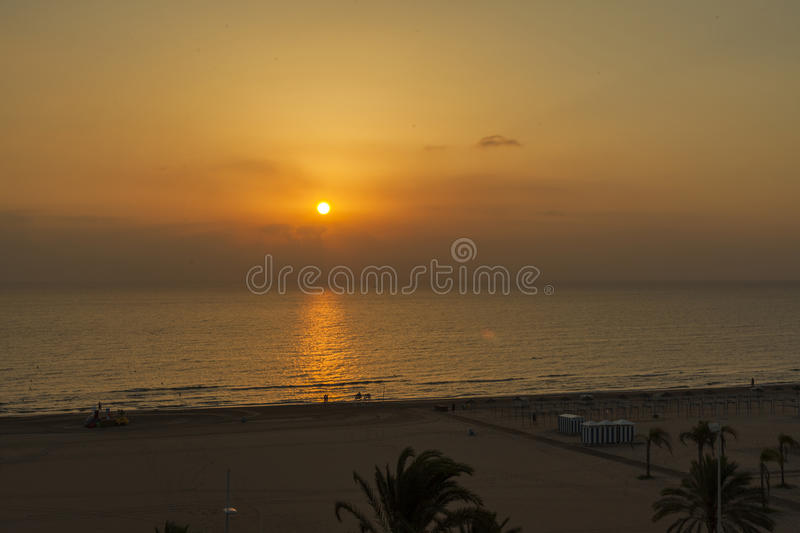 Sunrise horizon line between sky and sea in a sunny day. At the beach royalty free stock photos