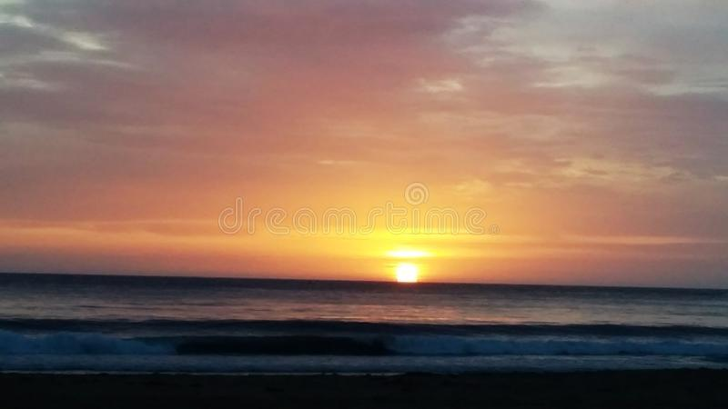 Sunrise on the Horizon. The sun was rising on the Horizon to herald the beginning of a new day. It is a beautiful time of the day stock photography