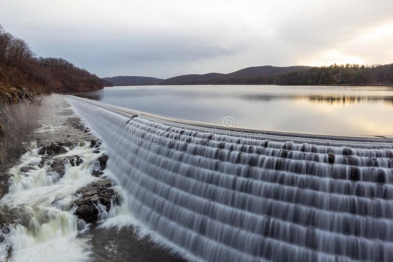 Croton-On-Hudson, NY / United States - Jan 12, 2020: sunrise view of the New Croton Dam, spillway and reservioir from the iron. Sunrise horizontal image of the stock photo