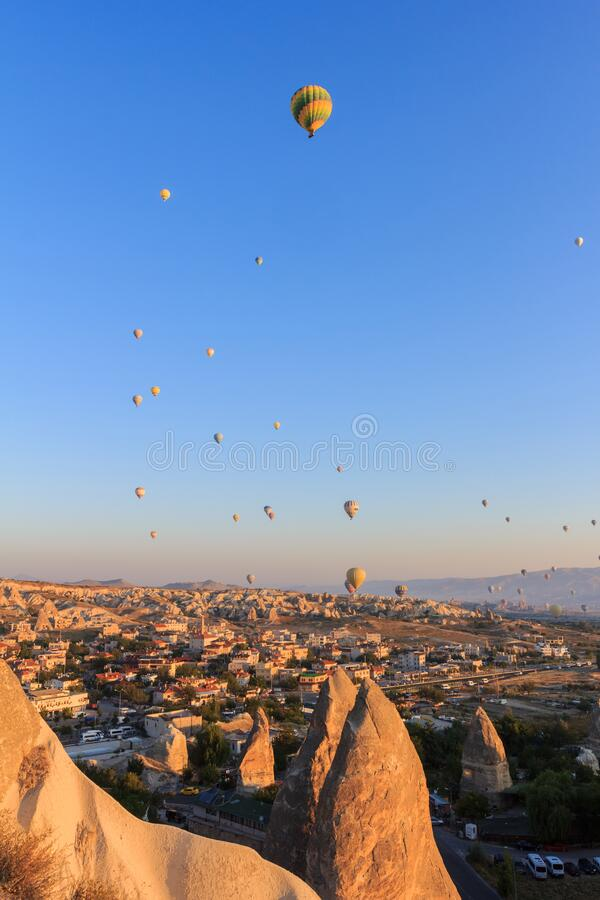 Sunrise with hot air balloons. In mountains of Cappadocia, Turkey royalty free stock photos