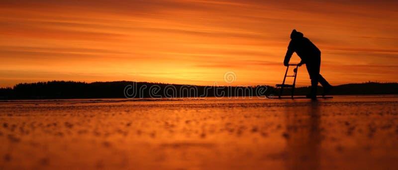 Sunrise on ice stock photography