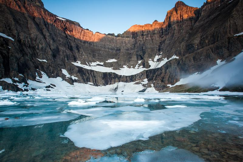 Sunrise at Iceberg lake in Glacier National Park, Montana, USA stock photography