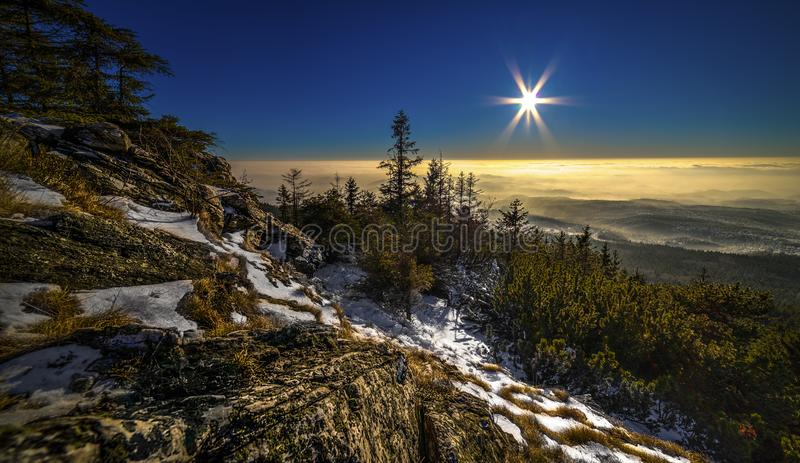 Sunrise and Inversion at Jested mountain close town Liberec, Czech republic, snow and winter and view of funicular. The best photo royalty free stock images