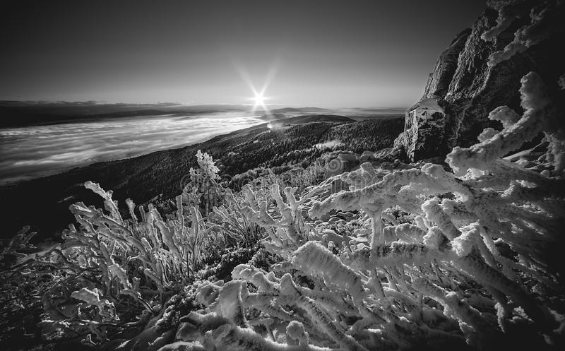 Sunrise and Inversion at Jested mountain close town Liberec, Czech republic, snow and winter and view of funicular, snow corals,. Black and white, the best stock photo