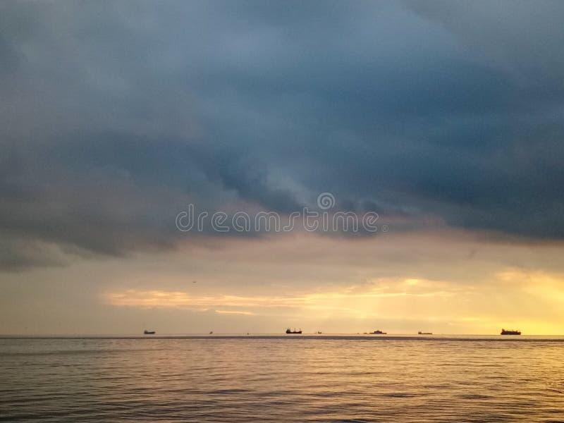 Sunrise in Kadikoy, Istanbul, Turkey. Bosporus sea seaview horizon clouds sky ship ships water royalty free stock photos