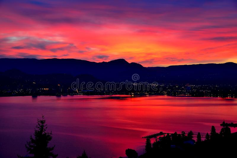 Nearly Sunrise on Lake Okanagan BC Canada. Bright Red Sunrise Over Lake Okanagan Looking stock photography
