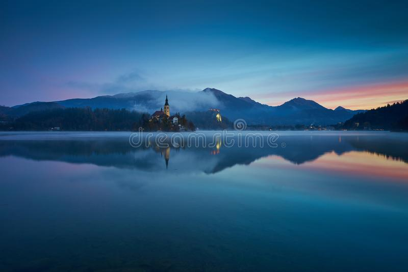 Sunrise at Lake Bled in the fall. Sunrise at Lake Bled in the fall in the early november morning royalty free stock photos