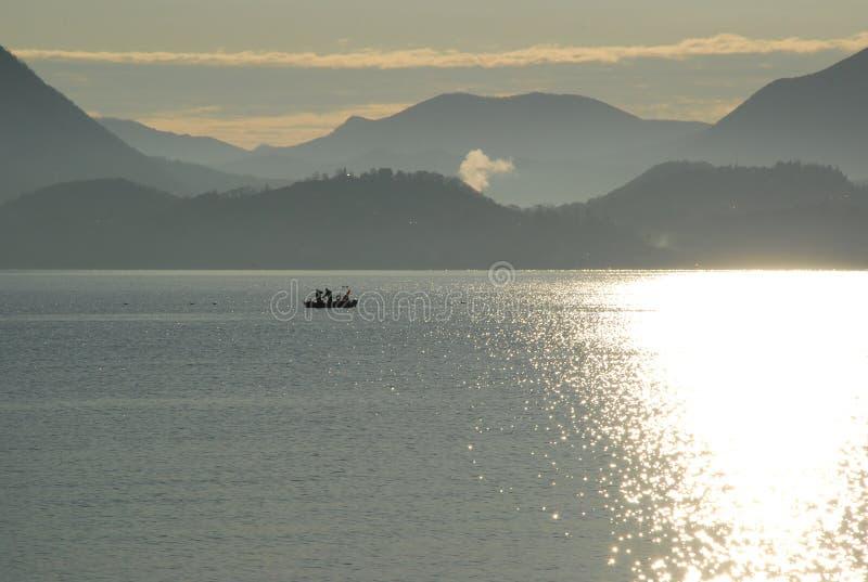 Sunrise on Lake Maggiore. Fishermen at Sunrise. LAke Maggiore, Italy stock image