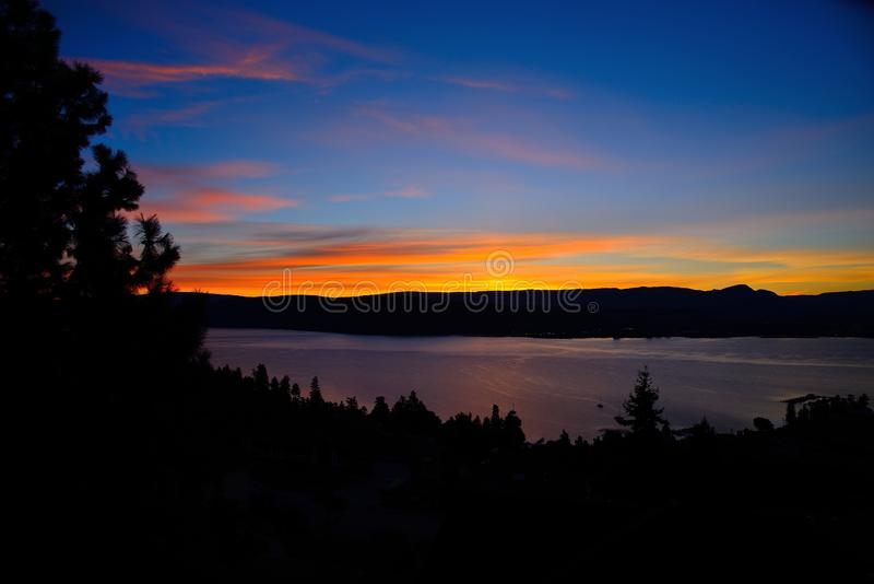 Almost Sunrise, Blue Sky Dawn on lake Okanagan BC. Scenic lake Okanagan, BC Canada with deep blue sky stock images