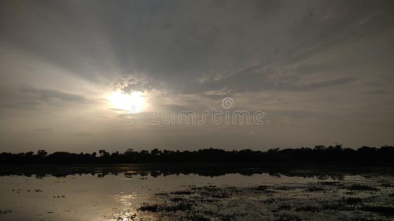 Sunrise on the lake side stock photo