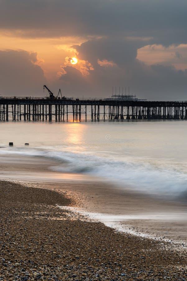 Sunrise landscape of pier under construction and development. Sunrise landscape over pier under construction and development stock photos