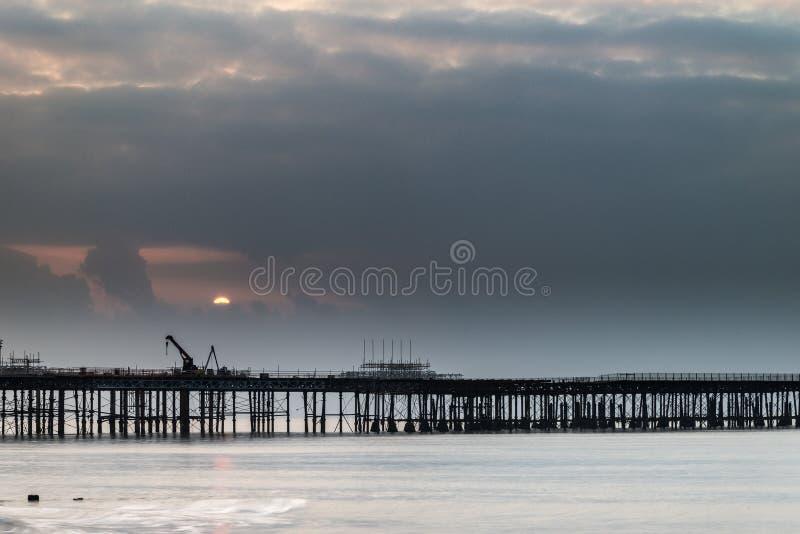 Sunrise landscape of pier under construction and development. Sunrise landscape over pier under construction and development royalty free stock image