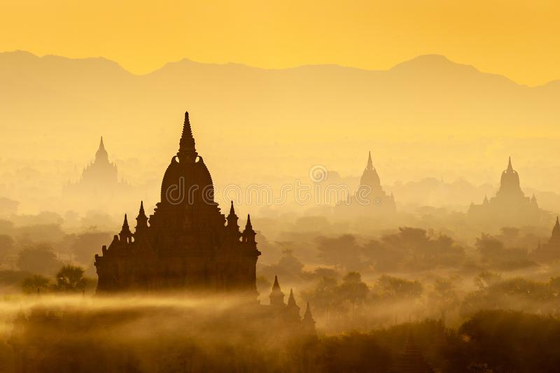 Sunrise landscape view with silhouettes of old temples, Bagan, Myanmar Burma stock photos