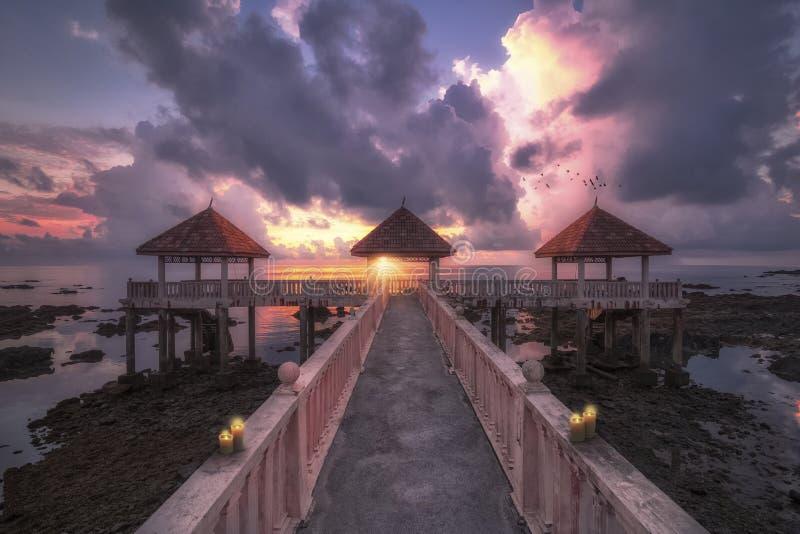 A sunrise at the long Desaru jetty - Desaru beach stock photos