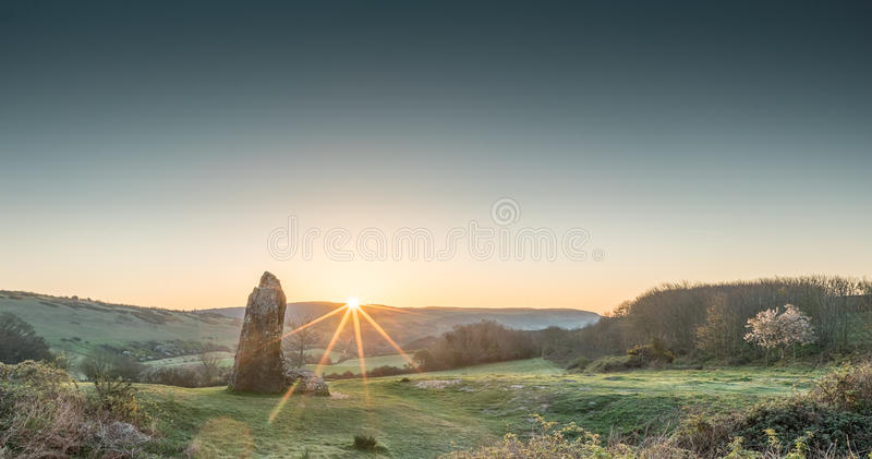 Sunrise at the Long Stone. Dawn at the Long Stone. A Neolithic stone on Isle of Wight stock images
