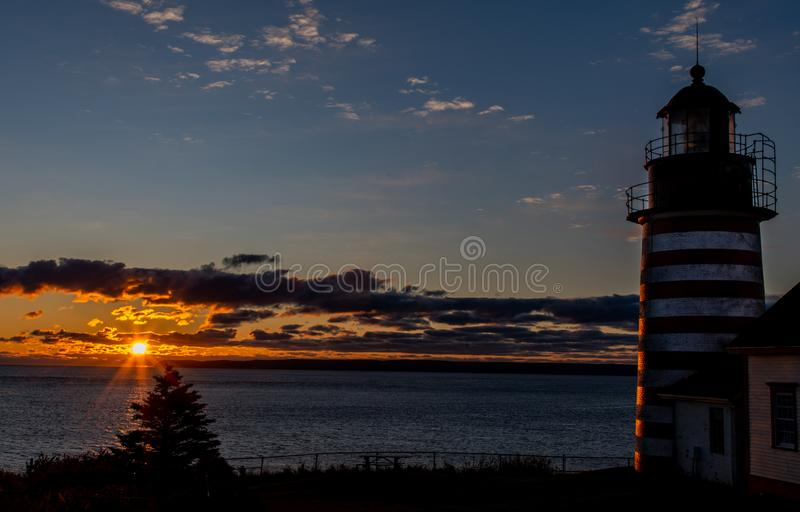 Sunrise at a Maine Lighthouse. West Quoddy Head Lighthouse in Maine royalty free stock photography