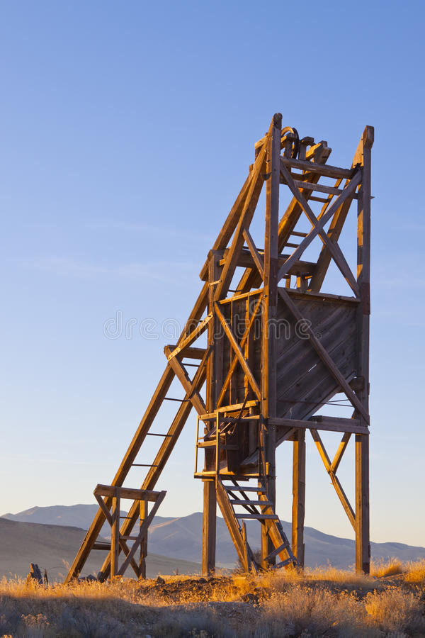 Sunrise Mine Shaft. Timbered Mine Shaft Head Frame in the Nevada Desert at Sunrise royalty free stock photography