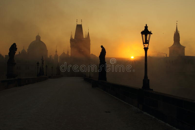 Sunrise on the misty Charles bridge