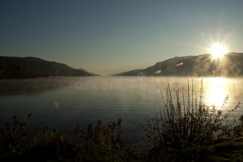 Download Sunrise On A Misty Lake - New Day - Peaceful And P Stock Image - Image: 38256033