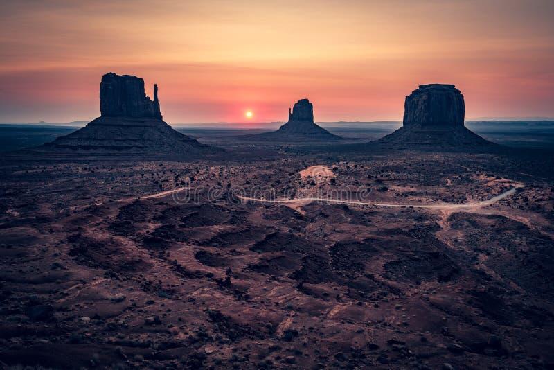 Sunrise behind the Mittens, Monument Valley, Arizona stock photos