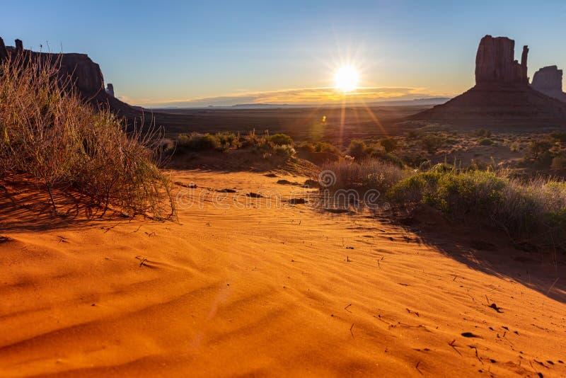 Sunrise at Monument Valley Tribal Park in the Arizona-Utah border, USA. Monument Valley desert at sunrise. Navajo Tribal Park in the Arizona-Utah border USA. Sun royalty free stock images