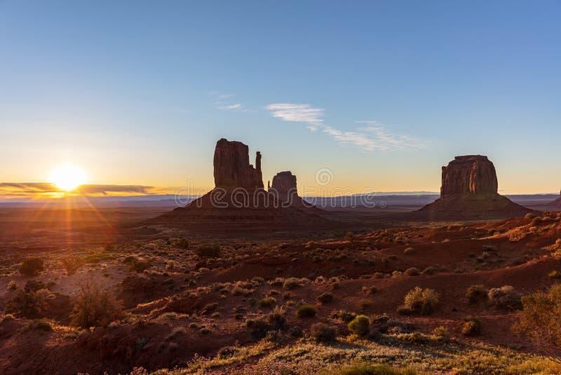 Sunrise at Monument Valley Tribal Park in the Arizona-Utah border, USA. Monument Valley desert at sunrise. Navajo Tribal Park in the Arizona-Utah border USA. Sun royalty free stock photography