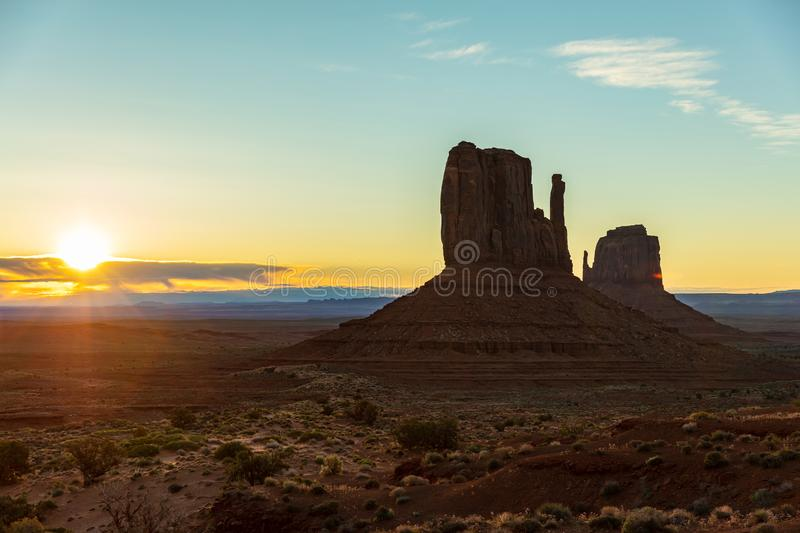 Sunrise at Monument Valley Tribal Park in the Arizona-Utah border, USA. Monument Valley at sunrise. Navajo Tribal Park in the Arizona-Utah border USA. Sun rising royalty free stock photo