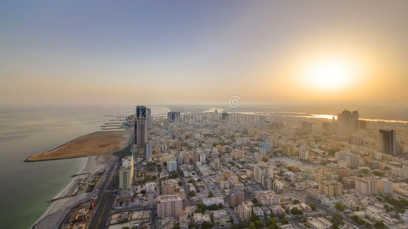 Sunrise and morning with Cityscape of Ajman from rooftop timelapse. Ajman is the capital of the emirate of Ajman in the United Ara royalty free stock image