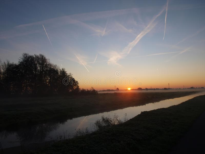 Sunrise with morning fog over the meadows of the polder at Goudarak close to Gouda in the Netherlands. royalty free stock images