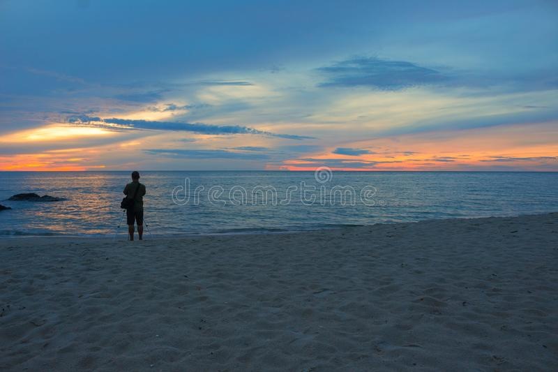 Sunrise morning time before, cameraman on the beach. Beautiful Colorful sky and water in lake reflected. Select focus with shallow depth of field, Soft focus royalty free stock photos