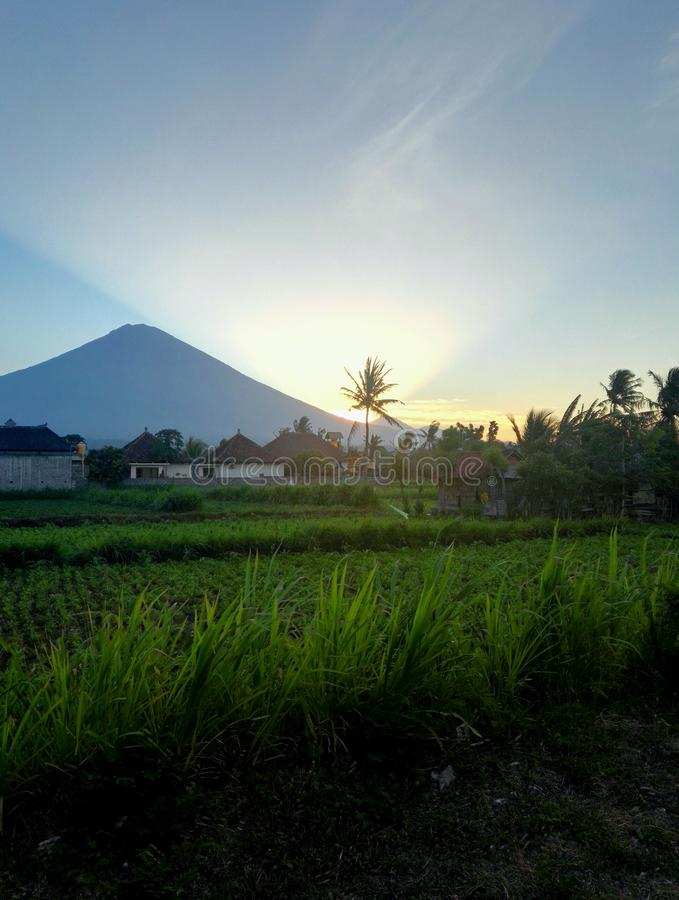 Mount agung bali. Sunrise mount agung from amed royalty free stock images
