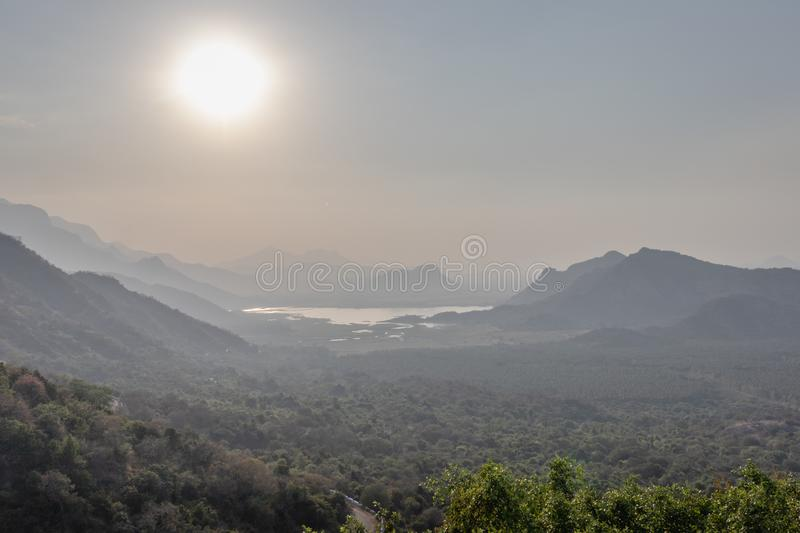 Sunrise in the mountain above lake. Image is taken at echo village kodaikanal showing the nature royalty free stock photography