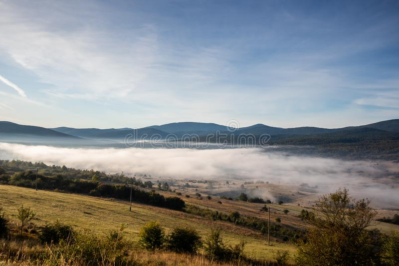Sunrise on mountain with colorful skyline and fog Near the Drvar. In Bosnia and Herzegovina royalty free stock images