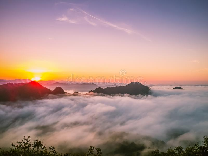 Sunrise on the mountain mist. Sunrise on the mountain mist in the morning stock photography