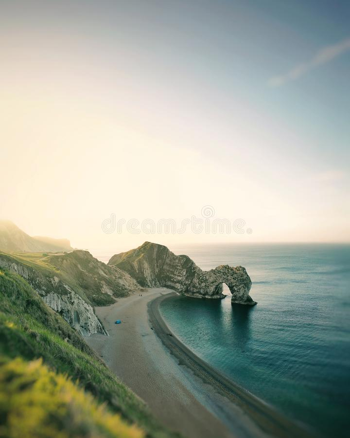 Sunrise mountain sky clouds ocean royalty free stock image