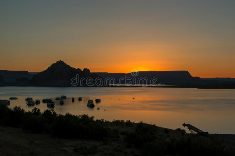 Sunrise with the mountains in the background stock photography