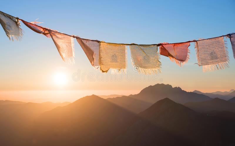 Sunrise in the mountains, colorful prayer flags. Sunrise in the mountains, fluttering colorful prayer flags. meditation design royalty free stock image