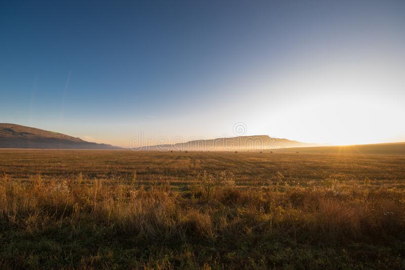 Sunrise in the mountains landscape at the field royalty free stock images