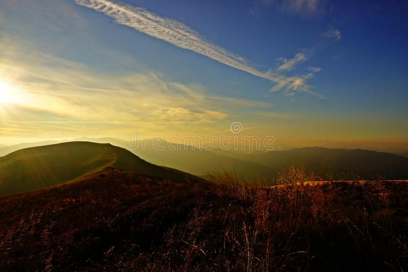 Sunrise in the mountains. In Polish Bieszczadach mountains a peak is one of the most recognizable massifs Polonina Carynska. Photograph done at dawn from the stock photos