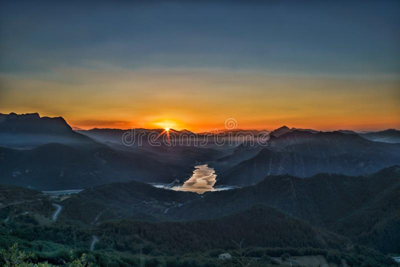 Sunrise between mountains royalty free stock image