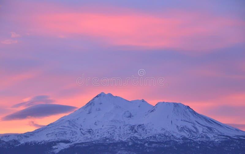 Sunrise Mt Shasta back lit stock photo