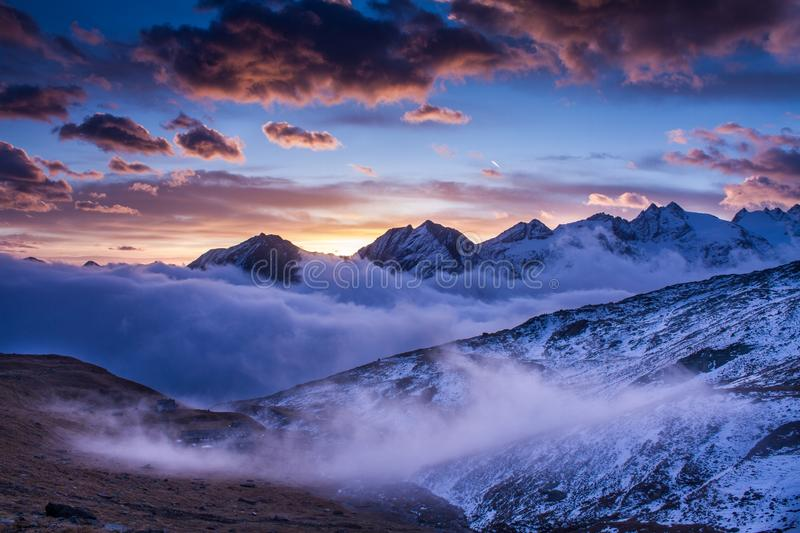 Sunrise in Gran Paradiso National Park Italy. Sunrise in National Park Gran Paradiso. Beautiful sunrise scenery. Mist during sunrise in Alps Italy, beautiful royalty free stock photos