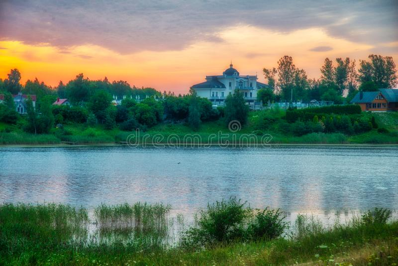 Sunrise near lake in summer royalty free stock photo