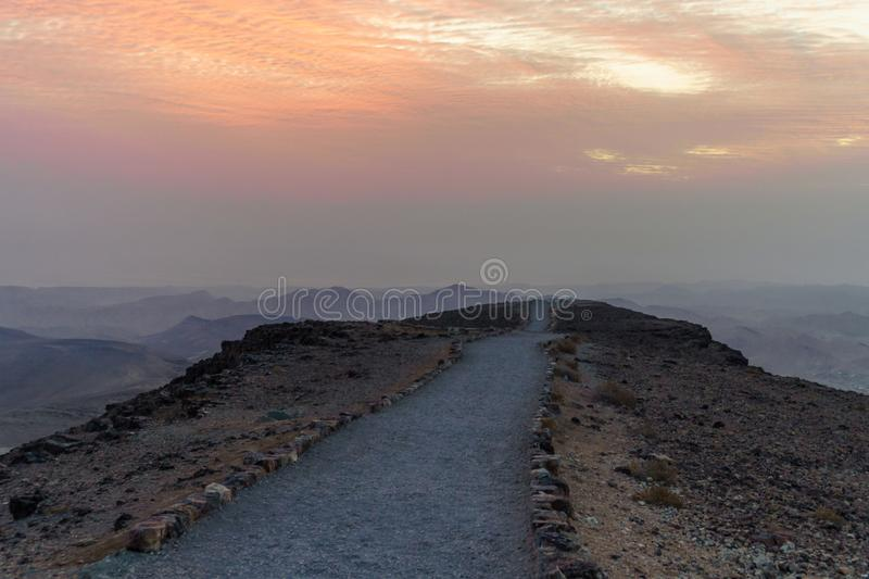 Sunrise in negev desert in israel. Mountain road to colorful horizon view stock image
